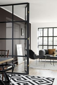 Beautiful and Practical: Windows Indoors | Apartment Therapy: A steel room divider mimics the steel window in this elegant, modern space from The Design Chaser.
