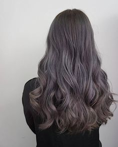 Cool tones of ash grey and beige meet in this beautiful hair colour styled in loose curls.