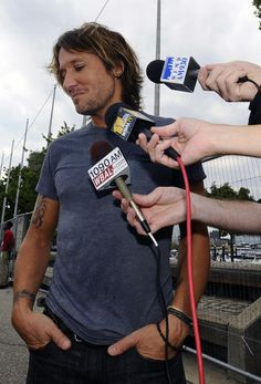 Singer Keith Urban talks with local news media after checking sound and equipment. Urban performed a free concert in the Inner Harbor as part of the NFL season kickoff on Sept. 5.
