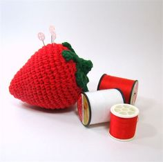 Crochet Strawberry Pincushion, Sewing Pincushion, Strawberry Kitchen Decor  What could be better than a strawberry pincushion to hold all your pins and needles?  Made of 100% cotton yarn, this strawberry pincushionand is stuffed to the brim with polyester fiberfill, making it all chubby and cute! It measures 4 inches tall and 3 inches wide (10cm x 8cm) so it will hold lots of pins and wont get lost on your sewing table!  The green leaves are securely sewn on top and the tips flip up a…