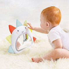 Baby will love checking out her reflection with the SKIP*HOP Silver Lining Cloud Activity Mirror. This mirror gets baby engaged with crinkle fabric, neon colors to develop eyesight, and a cloud-shaped teether for sore gums. Newborn Toys, Baby Toys, Toddler Toys, Baby Mirror, Baby Crib Bedding Sets, Activity Mat, Baby Jogger, Baby Swings, Baby Learning