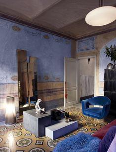 Dans le salon, la table basse en béton et marbre noir Isometrico 01 est une édition limitée de Duccio Maria Gambi, 2016 (Nero Design Gallery). Dessus, un singe en céramique de la manufacture Zaccagnini, à Florence, années 1940, et un vase en verre de Cenedese, à Murano, années 1960. De g. à dr., une lampe Zan-Zo de Marco Ferrari (Fontana Arte) datant de 1989, une œuvre en laiton miroir de Michele Seppia, 2005, un fauteuil en velours de Lenzi, années 1950 et un cabinet Brosse d'Inga Sempé…