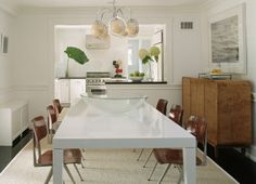 White Parsons table, School house chairs, Burlwood buffet in this clean and modern dining room.