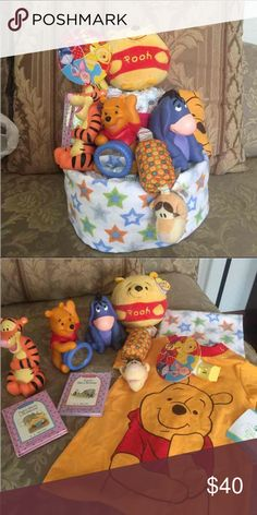 Winnie pooh diaper cake unisex Receiving blanket Winnie the Pooh  onesie 3 plastic rattles toys Tigger clip in rattle Pooh night light 2 pooh books Pooh ty ball  Diapers  Wrap in plastic with ribbon Disney Accessories
