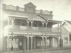 Camden NSW, Old Foresters Hall at 147 Argyle Street. Entrance to Empire Theatre at the centre with shops either side. Camden News Printing Works office to right. 1920. Copyright Camden Historical Society.