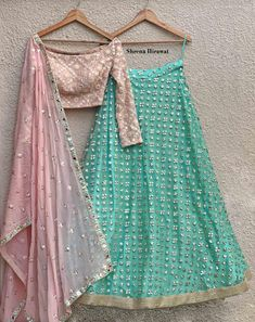Baby Pink Blouse with mirror work detailing teamed with an aqua mint mirror work lehenga with borders.Georgette Pink Dupatta with mirror butis and a beautiful embroidered border. Half Saree Lehenga, Lehnga Dress, Lehenga Blouse, Indian Lehenga, Net Lehenga, Simple Lehenga Choli, Baby Lehenga, Green Lehenga, Bridal Lehenga