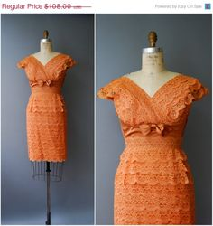 1950s rich orange lace dress with tiers of scalloped lace along the slender skirt, surplice bodice and cap sleeves, tiny rhinestones sprinkled