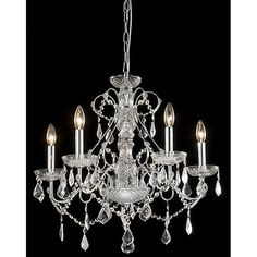 Five bright 60-watt candelabra bulbs reflect their light over the clear accents of this chrome-finished crystal chandelier to add real sparkle to your dining room or living room. Its sturdy iron construction maintains its elegant appearance for years.