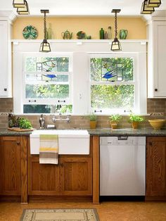 How to update oak kitchen cabinets with paint. By BHG shown with Granite countertops and glass subway tile and cork flooring