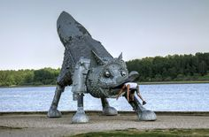 """A huge iron fox sculpture was erected on the bank of the Talkša Lake in Šiauliai in December 2009. The sculpture is 7 metres high, 25 metres long and weighs 7 tons. The iron fox, a symbol of inventiveness and wisdom, was made to commemorate the 1000 year anniversary of the name of Lithuania.   The structure of the fox has a """"heart"""" with a built-in time capsule for future generations. The heart is made of galvanized metal and fitted in the statue exactly in the """"usual place"""" for the heart."""