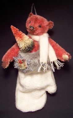 Beautiful red bear in Christmas mitten made by Brenda Power.....