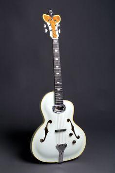 Royale archtop guitar. SO beautiful :D love how unique it is