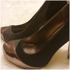 """Madden Girl Faux Suede  Metallic Platform Pumps Madden Girl Faux Suede  Metallic Platform Pumps --- 6.5 --- 4.5"""" heel --- 1"""" platform --- Shoes are adorned in black and grey fraud suede with a bronze colored toe --- scratch on toe of left shoe as pictured --- good preloved condition Madden Girl Shoes Heels"""