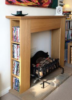 This is kind of brilliant - hack an IKEA dvd tower into a storage mantle.