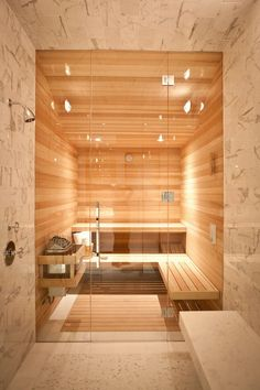 A stunning stone steam room leads to the interior sauna. | A 1913 Edwardian Home Becomes a Modern Masterpiece | POPSUGAR Home Photo 9