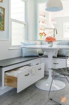 This custom kitchen banquette provides comfortable seating and extra storage. It also opened up some of the floor space in blogger Joni Lay's kitchen makeover. Joni has more on this kitchen remodeling project and the design choices that turned her small s