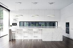 Minimal white kitchen space. The floors are perfection.