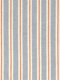 Loving the orange & blue striped rug. Right colour scheme