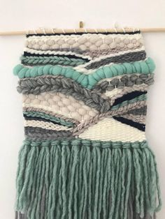 Handwoven wall hanging - aqua, navy, grey and cream Handwoven wall hanging made on hand loom from various fibres and yarns. Off-white warp with aqua, navy, grey and cream The size is approximately 20 inches long by 9 inches wide. Includes unfinished wooden dowel, 12 inches long. Weaving Loom Diy, Weaving Art, Tapestry Weaving, Hand Weaving, Weaving Wall Hanging, Tapestry Wall Hanging, Wall Hangings, Textile Design, Textile Art