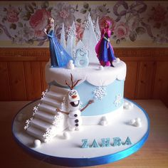 Frozen themed cake for princess Zahra. Elsa and Anna are plastic toppers provided by customer. Olaf is handmade and edible. Anna Elsa Cake, Anna Frozen Cake, Anna Und Elsa, Frozen Theme Cake, Disney Frozen Cake, Elsa Cakes, Frozen Cake Topper, Elsa Birthday Cake, Castle Birthday Cakes