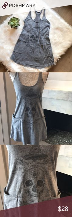 """Over Skull Tunic or Dress The remedy is worst than the disease!  Soft Cotton.  2 Pockets in the front.  Measurements laid flat:  31"""" long.  Under arms - 13.5"""".  Waist - 15"""".  Across bottom - 20.5"""".  Wash Delicate & hang dry! Obey Tops Tank Tops"""