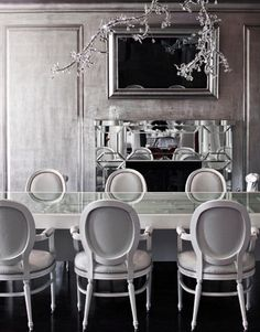 Max and Lubov Azria  The dining room is illuminated by a Tord Boontje for Swarovski Crystal Palace chandelier.