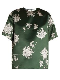 Rochas masters autumnal florals with this jewel-tone duchess-satin top. It's printed with sprawling white dahlias on a gleaming forest-green background, and cut to a boxy T-shirt silhouette. Double up with the matching trousers, and add height with vertiginous velvet platforms.