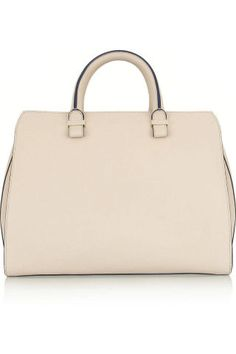 10 things every woman should own before 30: A forever bag, Victoria Beckham.