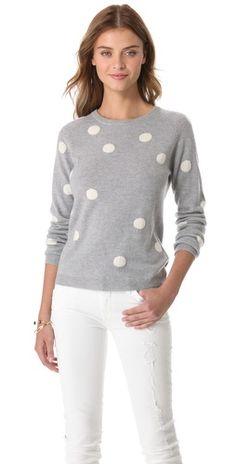 polka-dot cashmere sweater.