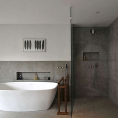 Concrete is becoming a popular option in many interior bathrooms, both because of the utility of the material, and its ability to be painted, stained, and etched.