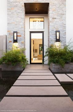 Natural Stone Veneers International, Inc.'s Nickel Ledgestone™ was used around the front door of this home. Exterior Colonial, Modern Exterior, Exterior Design, Natural Stone Veneer, Natural Stones, House With Porch, House Front, Stone Front House, Front Entry