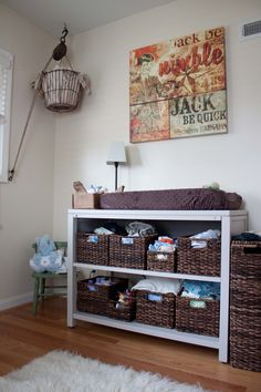 Rustic nursery. Old pulley with egg basket holding diapers