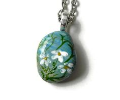 This is a One of a kind hand painted FLOWER on a stone pendant. It comes complete with a 24 inch petite silver ball chain. This wearable art