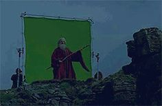 Colin Morgan as Merlin. As Gragoon.  On set. Using his staff as an air guitar. (Click to see the gif.)