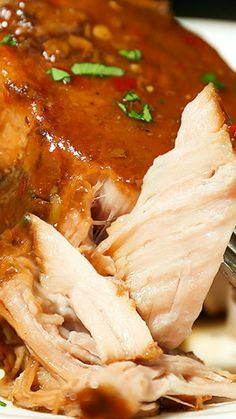Crockpot Pork Chops ~ The easiest slow cooker recipe ever... Toss it all in the crockpot and you return to perfectly tender, melt in your mouth pork cooked in the most spectacular sauce. It is a little sweet, a little spicy, a little barbequey and a lot delicious.