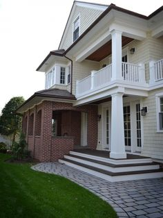 Red brick house and two story columned porch - addition