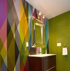 The '50s and '60s were full of colorful experimentation on the interior design front, so bring a bit of mid-century modern funk to your rental. Here, a brightly colored geometric wallpaper brings a simple bathroom straight back to the swinging '60s. Make sure to get an adhesive, removable wallpaper designed specifically for rentals.