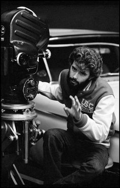 George Lucas on the set of American Graffiti, filmed in and around the Bay Area. California, 1972. By Dennis Stock