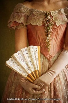 Trevillion Images - victoria-woman-holding-fan