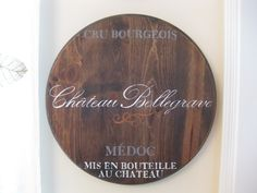 Ballard Designs Knock-Off: Wine Barrel Plaques - Lowes has wood circles so can use for the knock-off clock too!