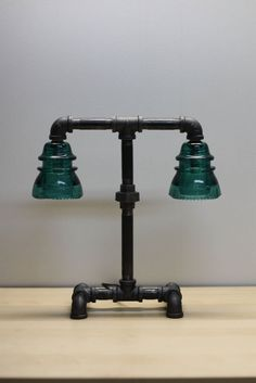 Made from strong 1/2 inch gas pipe and fitted with a vintage glass insulator, this desk lamp is sure to turn a few heads and provide a little ambiance to any room.