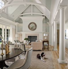 Grand Fireplace w/ vaulted ceilings & beams....like the idea of open plan w/ dining and living rooms