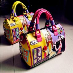 """A stunning flavorful and cheerful tote shoulder handbag. Have fun with these delightful creative and colorful designs. Length 12.5"""" / Width 7"""" / Height 9.45"""" / Strap Height 5"""" Colors: Vary / As Shown Materials: PU Leather Free Shipping and Tracking"""