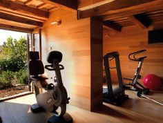 Modern home gym in old stone house