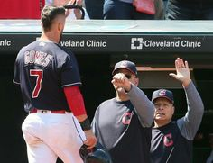 Cleveland Indians Yan Gomes gets congrats at the Indians dugout from manager Terry Francona and Brad Mills after Gomes scored the Indians first run on a double by Giovanny Urshela against the Baltimore Orioles in the 3rd inning at Progressive Field, Cleveland, Ohio, on September 9, 2017. (Chuck Crow/The Plain Dealer). Indians won 4-2