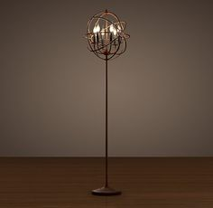 "Foucault's Iron Orb Floor Lamp Rustic Iron -   DIMENSIONS  19"" diam., 70""H  Weight: 25.8 lbs.  $695"