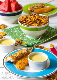 cheesy pretzel baked chicken tenders on a stick with honey mustard sauce