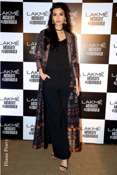 A long-line jacket with full sleeves, with exquisite dori, resham, gota patti and sequin embroidery in floral motifs, as seen on Diana Penty.
