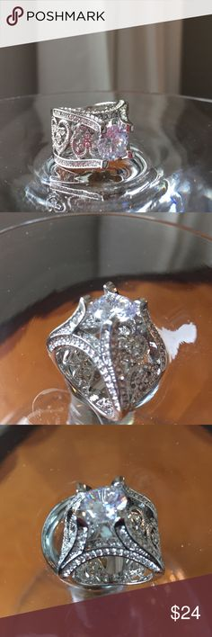 VINTAGE STYLE STUNNING RING SZ 9 18k White gold plated wide band with large AAA CZ mounted high to allow light underneath the beautiful center CZ. Sparkles sparkles sparkles💍💍💍💍💍 Jewelry Rings