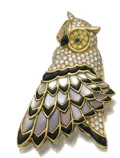 A diamond, onyx, gold and mother of pearl owl brooch by Tiffany & Co